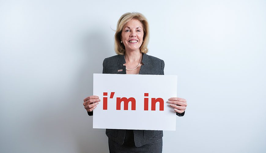 "Elizabeth Dale holding a sign that says ""I'm In"""